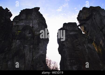 Low Angle View Of Rock Formations Against Sky - Stock Photo