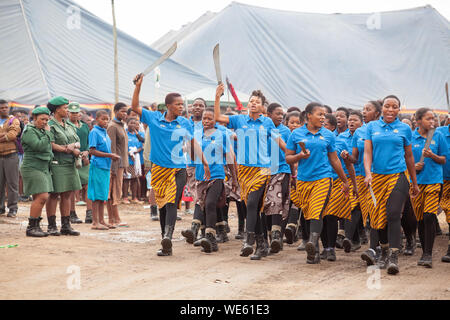 Mbabane, Swaziland - August 31, 2017: Umhlanga Reed Dance ceremony traditional rite young virgin girls with big knives machete go to field to cut reed - Stock Photo