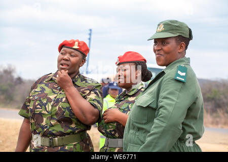 Mbabane, Swaziland - August 31, 2017: three african women officer in red beret and green uniform of Umbutfo Swaziland Defence Force (USDF) - Stock Photo