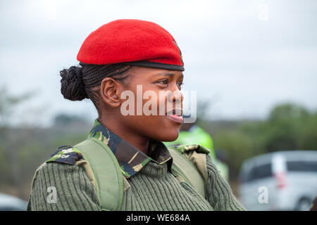 Mbabane, Swaziland - August 31, 2017: young african woman officer in red beret and green uniform of Umbutfo Swaziland Defence Force (USDF) - Stock Photo