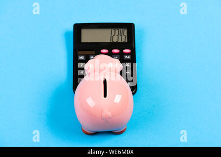 Analyzing sales. income capital management. planning and counting budget. bookkeeping. financial problem. moneybox with calculator. Piggy bank. money saving. Accounting and payroll. - Stock Photo