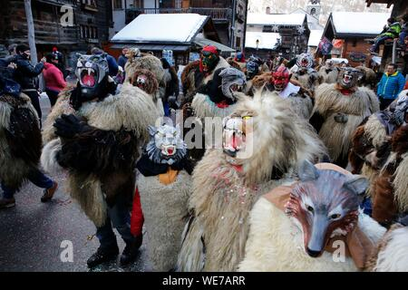 Switzerland, Valais Canton, Val d'Herens, village of Evolene, Carnaval, peluches disguisment of young people and children dressed with a coat made of animal fur and a carved traditional wooden mask made in the village representing mythical animals - Stock Photo