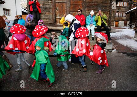 Switzerland, Valais Canton, Val d'Herens, village of Evolene, Carnaval - Stock Photo