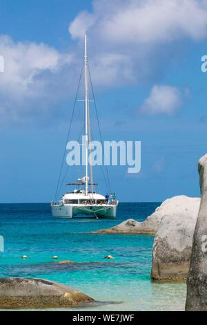 West Indies, British Virgin Islands, Virgin Gorda Island, The Baths, The Baths Beach View, Mooring Cruise Catamaran, in the foreground the typical rocks that surround the paradisiacal swimming area