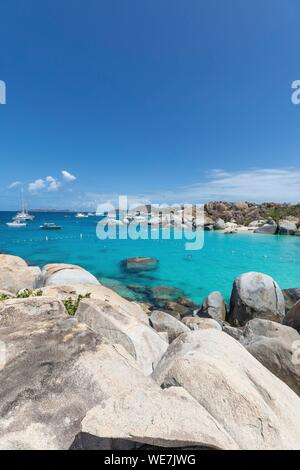 West Indies, British Virgin Islands, Virgin Gorda Island, The Baths, bathing beach view, sailboats at anchor, in the foreground the typical rocks that surround the paradisiacal swimming area