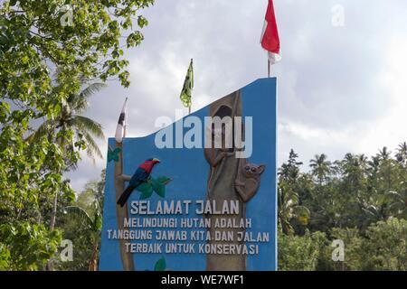 Indonesia, Celebes, Sulawesi, Tangkoko National Park, Sign at the entrance to the village of Tangkoko - Stock Photo