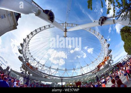 London, England, UK. London Eye / Coca-Cola London Eye / Millennium Wheel on the South Bank - fisheye view - Stock Photo