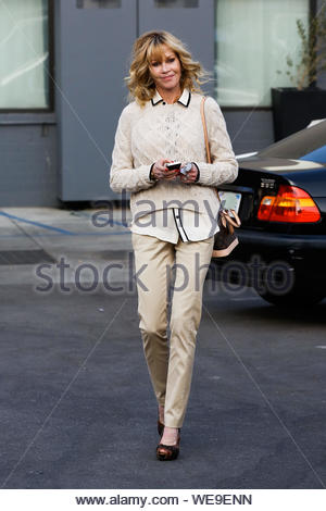 Beverly Hills, CA - Actress Melanie Griffith is all smiles as she arrives at Rossano Ferretti Hairspa in Beverly Hills. AKM-GSI November 15, 2013 - Stock Photo