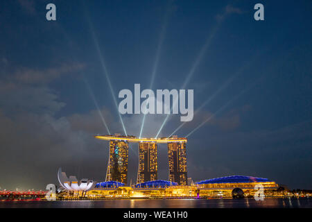 Marina Bay Sands Hotel at night time with the light show in Singapore