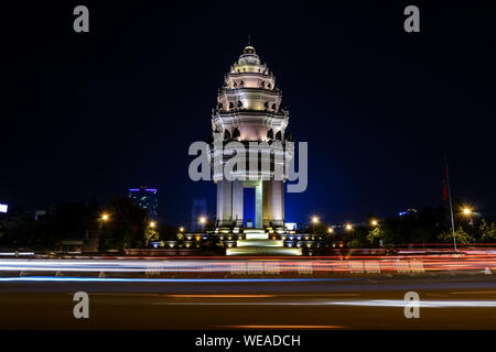 Light Trail On City Street By Illuminated Independence Monument Against Sky - Stock Photo