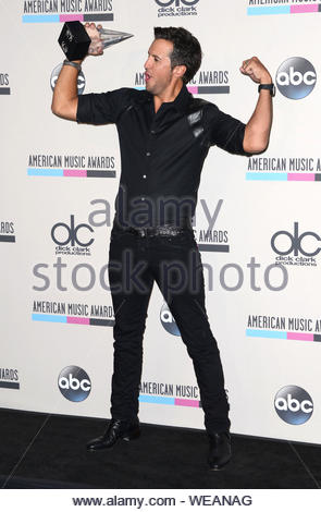 Los Angeles, CA - Luke Bryan, winner of Favorite Male Country Artist, poses with his award at the 2013 American Music Awards Press Room. AKM-GSI November 24, 2013 - Stock Photo