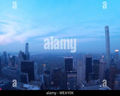Cityscape Against Sky In Foggy Weather During Sunrise - Stock Photo