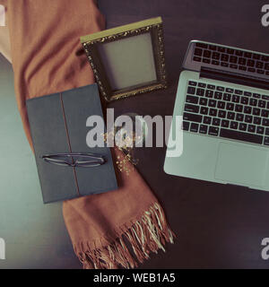 Directly Above Shot Of Laptops By Book And Eyeglasses On Desk At Home - Stock Photo
