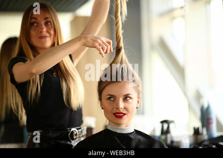 Woman Hairstylist Cutting Female Hair Photography - Stock Photo