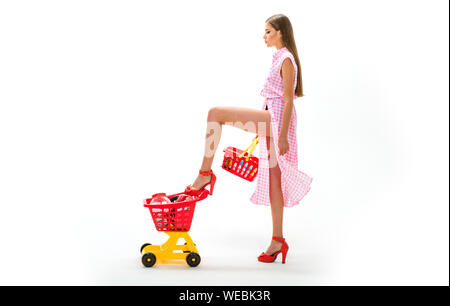 home delivery. woman going to make payment in supermarket. shopping girl with full cart. vintage housewife woman isolated on white. retro woman go sho - Stock Photo