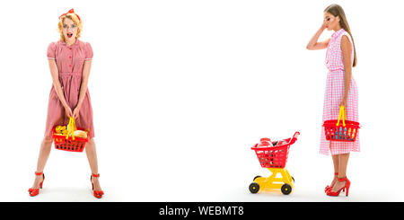 happy shopping girls with full cart. vintage housewife women going to make payment in supermarket. savings on purchases. retro women go shopping with - Stock Photo