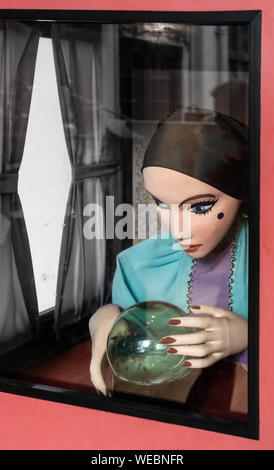 Fortune teller with crystal ball. - Stock Photo
