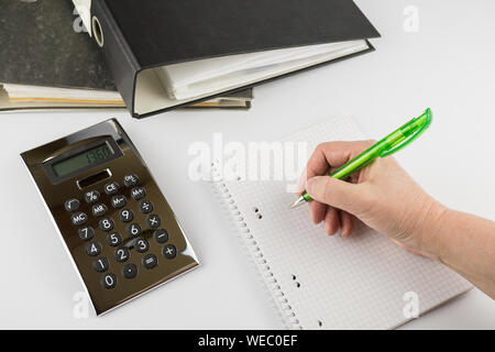 High Angle View Of Hand Writing On Book With Pen - Stock Photo