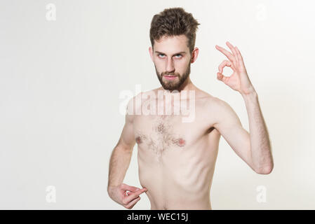 Its OK. Young man show skinny flat belly abs. Sport and fitness. Slim man do sport training. Stimulating muscle growth with anabolic steroids. Man inc - Stock Photo
