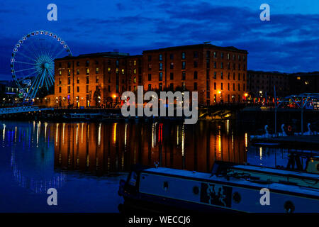 Albert dock Liverpool Ferris wheel at night with water reflection - Stock Photo