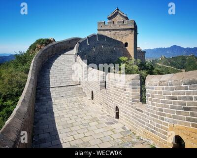 Walkway At Great Wall Of China Against Clear Blue Sky On Sunny Day - Stock Photo
