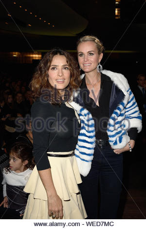 Paris, France - Salma Hayek and Laeticia Hallyday at the 'Reves d'Enfants' Arop charity event held at Opera Bastille in Paris. AKM-GSI December 15, 2013 - Stock Photo
