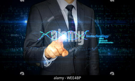 A businessman in a suit touch screen with biotechnology DNA helix hologram. Man using hand on virtual display interface. Bioinformatics, science, biol - Stock Photo