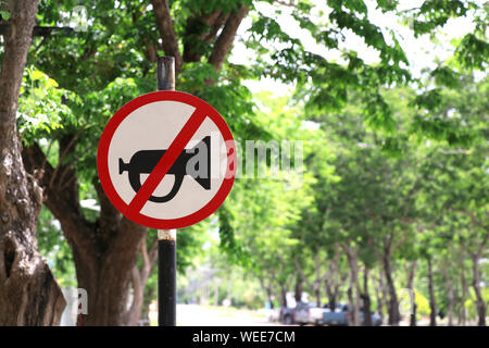 Signs that do not use horn horns in this area. Warning sign on the road. - Stock Photo