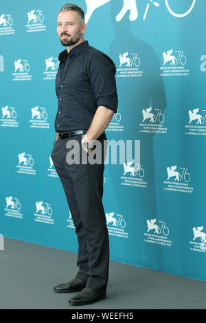 VENICE, ITALY - AUG 28: Murathan Muslu attends the Pelikanblut photocall during the 76th Venice Film Festival - Stock Photo