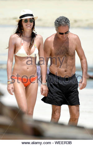 Malindi, Kenya - Elisabetta Gregoraci takes a stroll on a family vacation holding hands with her father. The brunette beauty showed off her tone figure in a cream and orange two piece bikini and cream and black fedora hat. AKM-GSI December 21, 2013 - Stock Photo