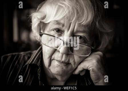 Close-up Portrait Of Senior Woman Wearing Eyeglasses - Stock Photo