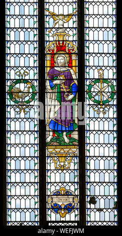 London, England, UK. Church of St Andrew Holborn. Stained glass window: Saint Peter - Stock Photo