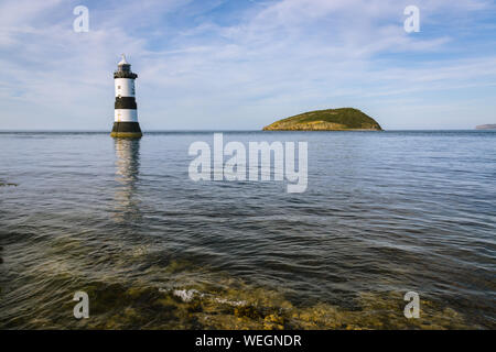 Penmon Point Anglesey North Wales with the Trwyn Du lighthouse and Puffin Island. The light was built between 1835 to 1838 - Stock Photo