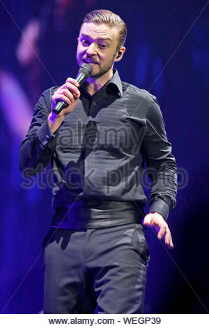 Vancouver, BC - Justin Timberlake takes to the stage and performs an energized show to a sold out Rogers Center in Vancouver, Canada. Justin makes a couple outfit changes from a black tux to a white jacket with a black vest. AKM-GSI January 16, 2014 - Stock Photo