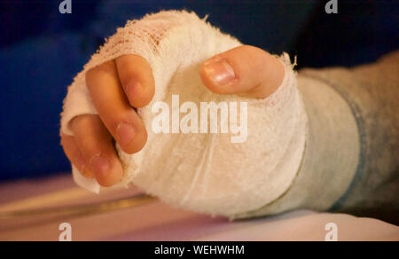 Cropped Hand With Bandages At Table In Hospital - Stock Photo