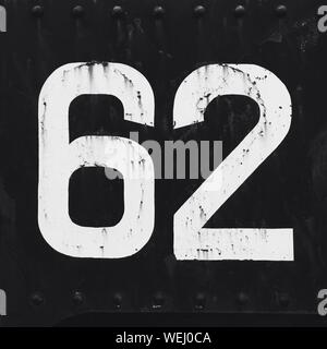 Number 62 Painted On Metal - Stock Photo