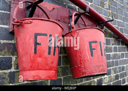 Close-up Of Fire Red Buckets - Stock Photo