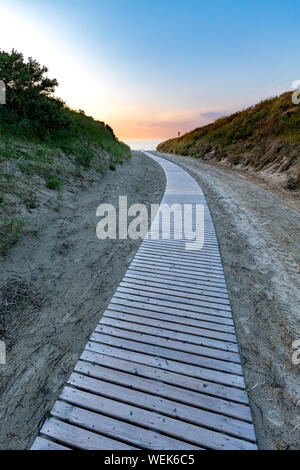 Sunset over the way to the beach on Juist, East Frisian Islands, Germany. - Stock Photo