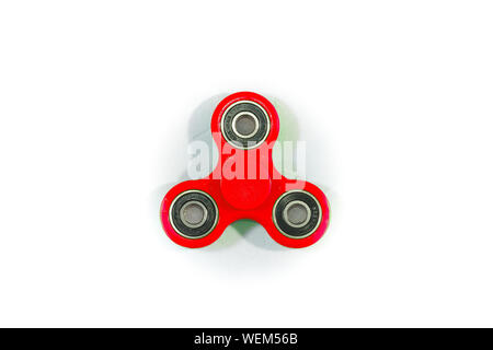 Close-up Of Red Fidget Spinner Over White Background - Stock Photo