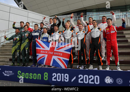 British competitors in the 2019-20 FIA World Endurance Championship pose for a group photo ahead of the opening round at Silverstone - Stock Photo