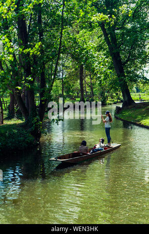 People In Boat Sailing On Lake - Stock Photo