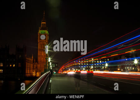 Light Trails On Westminster Bridge By Big Ben In City At Night - Stock Photo