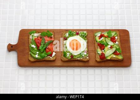 avocado toast open sandwich variety isolated on white background - Stock Photo