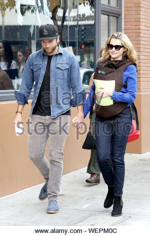 Glendale, CA - Actress Teresa Palmer steps out for the first time with her newborn baby boy, Bodhi, on her 28th birthday in Glendale today. The blond beauty ended up meeting with her husband, Mark Webber, after stopping by the Apple store earlier with her mom, Sandra and Bodhi. Teresa walked around with one hand on the back of her son, who was wrapped up in a baby carrier, and held hands with Mark with her other hand. The pair looked very happy during their family outing. AKM-GSI February 26, 2014 - Stock Photo