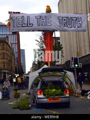Northern Rebellion protesters, part of the global movement Extinction Rebellion, blocked Deansgate and its side streets in central Manchester, uk, on 30th August, 2019 at the start of a four day protest. The protesters are demanding that the Government tells the truth about the climate emergency, takes action now, and is led by a citizens' assembly on climate change.