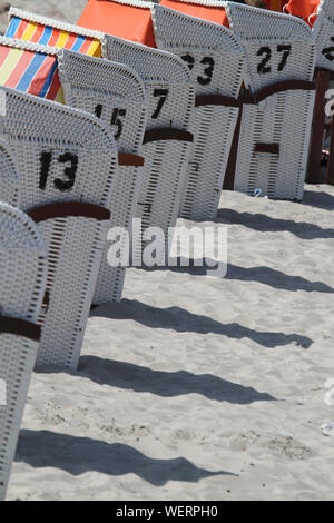 Hooded Beach Chairs In Row On Sand - Stock Photo