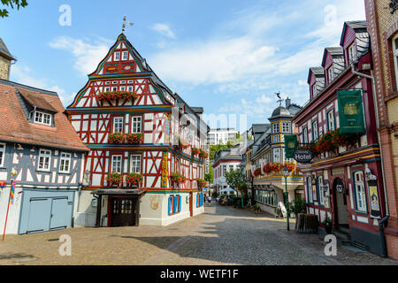 29 August 2019: Colorful Half-timbered (Fachwerkhaus) house, houses, Hotel, restaurant nearby marketplace in Idstein, Hessen (Hesse), Germany. Nearby