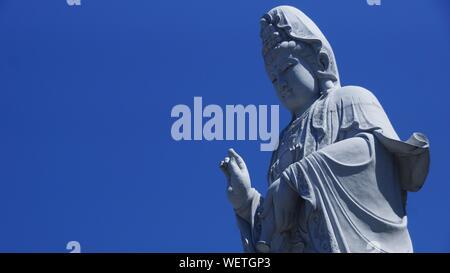 Low Angle View Of Guanyin Bodhisattva Statue At Nan Hai Pu Tuo Temple - Stock Photo