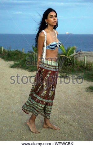 Rio de Janeiro, Brazil - Transsexual model Lea T joins her friends on top of a cliff in Rio for a talk and to see the Sunset. AKM-GSI March 13, 2014 - Stock Photo