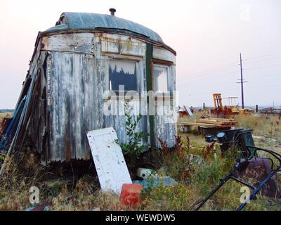 Scrap Metal In Junkyard Against Sky - Stock Photo